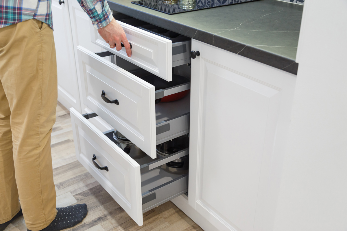 men-opensing-white-kitchen-drawers-VJEYLNA